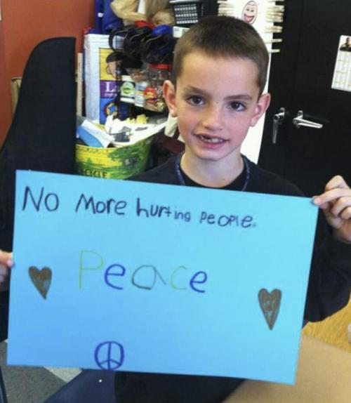 Boston Marathon bombing victim Martin Richard, 8, held a call for peace at a school event last year. He ended up dying a victim of violence.
